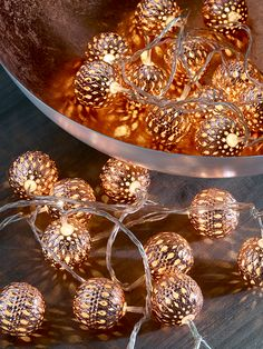 Made from lightweight metal with a copper colour finish, these lattice-cut large round warm white lamps create a soft evening glow when lit. Display them along a window sill, around a door frame or even around your Christmas tree.