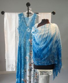 Hand Painted Silk Chiffon Poncho by Joyflower on Etsy $149 Elegant and Ethereal, lightweight and sheer, silk chiffon is versatile and easy to wear. Hand painted and stitched in Oregon. Measures 35 inches across and falls 22 inches from shoulder to hips.   Wear it like a scarf or a tunic, also may be worn as a shawl, poncho, head wrap, Euro-style.