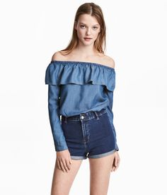 Check this out! CONSCIOUS. Wide-cut, off-the-shoulder blouse in denim made from Tencel® lyocell. Elastication and flounce at upper edge and long sleeves with buttoned cuffs. - Visit hm.com to see more.