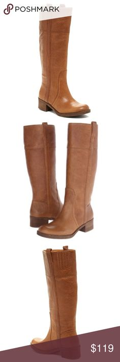 """Lucky Brand Hibiscus Knee High Pull-On Riding Boot New in Box. Richly pebbled leather defines a tall, timeless boot styled with a rounded toe, subtle stitching and pull-tabs at the cuff.  -Color: Dark Camel (Cognac/Brown) -Round toe -Leather construction -Topstitching -Pull-on -Approx. 14.5"""" shaft height, 15"""" opening circumference -Approx. 1.5"""" heel Lucky Brand Shoes Heeled Boots"""