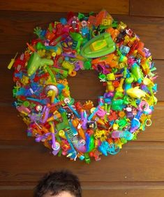 I hate fast food toys.  We have a lot of treat bag and holiday toys- appreciated, but plentiful.  I'm thinking this wreath looks like a great idea! For playroom art?  For a teacher's room? I don't know...but I'm gathering up our stuff tomorrow!