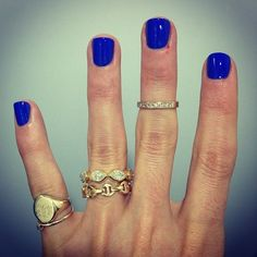 Cobalt blue mani. Love all these rings