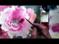 Preview Watercolor with Lian Quan Zhen: Peony& Hummingbird now to learn how to use cut-outs of flower drawings laid over a grid to create a pleasing composition, how to preserve the whites of your paper, how to create vibrant backgrounds, layer for value and contrast, and more! Then visit http://Artistsnetwork.tv for access to the full-length video workshop.