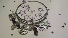 Check out this item in my Etsy shop https://www.etsy.com/listing/217686603/purple-bead-adjustable-bangle-pentagram
