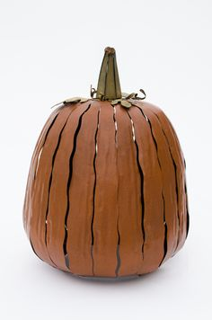 This pumpkin lantern luminary glows beautifully when lit at night with a candle or light. It delivers such a unique twist to your traditional jack o'lantern! www.shopboxhill.com