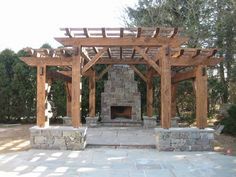 Timber frame pergola with stone fireplace