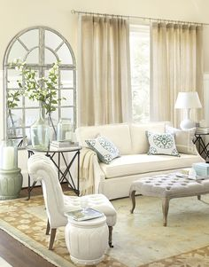 Creams and taupes are accented with spa blue in this relaxing living room