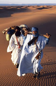 Morocco by Jack Hannaford - Berber tribesmen lead their camels through the sand dunes of the Erg Chegaga, in the Sahara region of Morocco. (MR)