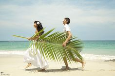 Bride and groom with palm tree leaf on the beach #thailand #beach #wedding #island Click the picture to see the whole photoshoot!
