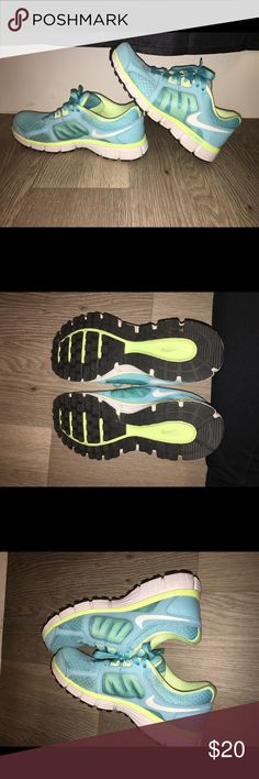 Nike Dual Fusion ST2 tennis shoes Blue, yellow insides. Like new, hardly worn. Little bit of a rub off from a pair of jeans on the inside if one shoe. Not visible from outside. Nike Shoes Athletic Shoes