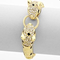 "Jaguar Head Bracelet - Gold Gold tone jaguar head bracelet. Perfect for wearing alone or stacking with other bracelets for the perfect Arm Candy  Size: Approx 0.6"" Height / 2.25"" Diameter  Stretchy fit - one size fits most  **Listing is for jaguar bracelet only** Jewelry Bracelets"