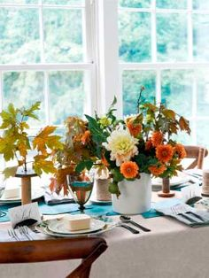 A lovely fall table setting. Great for Thanksgiving or just a dinner party! #centerpieces #fall #autumn #countryliving