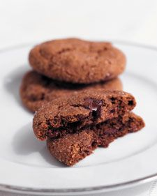 "A combination of fresh and ground ginger, molasses, and chunks of semisweet chocolate makes the cookies sophisticated enough for adults but chocolaty enough for children.This recipe is featured in ""Martha Stewart's Cookies."""