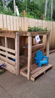 "Pallet dog porch for the play area - a place to put beds for the littles to lay down - railings to protect them from running dogs, but so I can still see in.  Also like the idea of a little garden on the top I can water by dumping the leftover dog water into. - Maybe have the ""deck"" area covered and put their water bowls there"