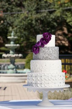When you can't decide, choose them all! Purple rose wedding cake with a layer of sparkle and piped flowers   Cakefections
