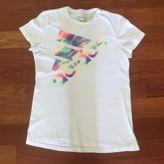 White adidas t-shirt w/ rainbow tie-dye lettering White adidas t-shirt with rainbow tie-dye lettering, in good condition slight pilling.happy shopping! Adidas Tops Tees - Short Sleeve