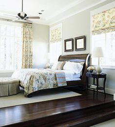 Like the light grey wall against the dark cherry wood sleigh bed