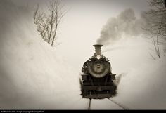 RailPictures.Net Photo: N&W 382 Norfolk & Western Steam 4-8-0 at Carpenters, Pennsylvania by Darryl Rule. In a view that the great O. Winston Link saw on a regular basis on the Abingdon Branch, N&W 382 passes through a snow bank as big as the engine as the engineer leans out the window checking the clearance. A Lerro Productions Charter with help from the Strasburg RR.