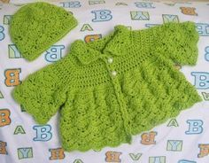 Butterfly Baby Sweater--apparently you can see butterflies in the texture, also has matching cap and booties, easy beg. level. Free pattern.