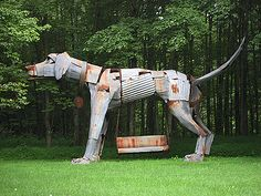 Dog sculpture made from corrugated metal scraps. I think this might be a lot of dog to take on... LOL