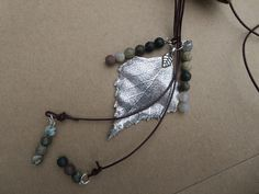 A personal favourite from my Etsy shop https://www.etsy.com/uk/listing/246397601/jasper-lariat-necklace-gemstone