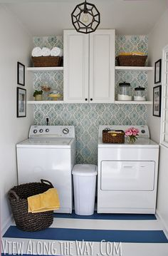 M- maybe laundry baskets above on left and right.  Slide out for detergent in between. I like (any) pattern behind wall too.