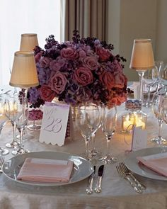 Romantic Centerpiece  Arrangements of pink and lavender hydrangeas and roses are surrounded by supper-club lamps for an old-fashioned flair.