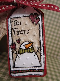 Neat idea -- run a card through the embossing machine after you've finished coloring.  (This is a cute tag!)