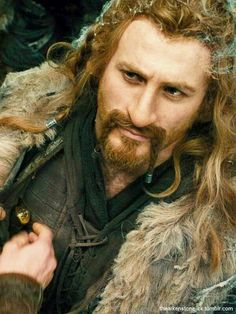 Fili!!!!!  I just love how the elves start pulling knives out of his hair!! :D