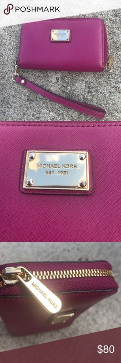 AUTHENTIC Michael Kors Wristlet Wallet 100% Authentic Michael Kors wristlet wallet. Pictures are taken in two different lighting settings. First one was taken in the shade outdoors versus the second one being taken in the sunlight outdoors. It is a nice pink/purple color with several credit card pockets as well as pockets to place your money. The wallet is basically in perfect condition (the zipper portion is slightly scratched) so feel free to make an offer on it! Michael Kors Bags Wallets