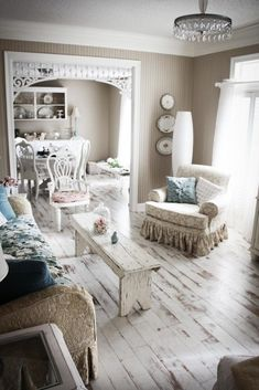 shabby chic: shabby living room~ note gingerbread in doorway I like the floor and all the little details.
