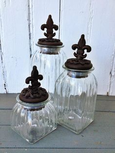 Glass Fleur de Lis Canister Set from Fleurty Girl - this would be great for storing things in the bathroom!