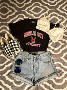 One of my favorite outfits..  University T-shirt Vintage jean shorts Vans Bralette Add a flannel if you want.. super simple but so cute