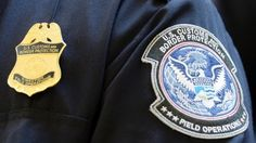 Feb. 20, 2014: A U.S. Customs and Border Protection arm patch and badge is seen at Los Angeles International Airport, California.