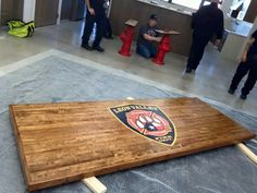 Refurbished bowling lane into an awesome firehouse table with the station's badge on it. Wouldn't any fireman love sitting at a table with their badge on it? Fire Dept, Fire Department, Fire Table, A Table, Firefighter Bar, House Logos, Fire Training, Garage Bar, Dream Properties