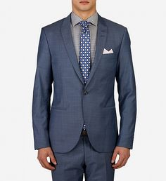 Mohair Look Suit by Tiger Of Sweden $799 | In a polished, fine wool blend with sharp, vertical stripes, Tiger of Sweden's slim-fitting Mohair-look suit exudes the brand's modern, understated appeal. The blazer comes fully lined with slim lapels and two-button closure for a flattering fit, while the trousers' narrow tailoring adds extra élan to this luxe style. Throw on a crisp white shirt and leather derbies for a sleek, finished look. | GOTSTYLE.ca