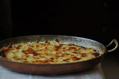 Pommes Dauphinoise (Potatoes au Gratin) -- I can smell this cooking now!