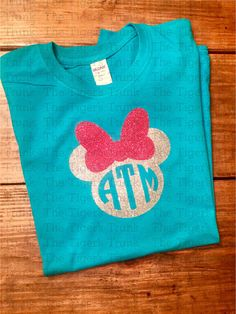Mickey- or Minnie-inspired personalized clothing items. These are made with HEAT PRESSED vinyl--great quality!  **Important information for ordering!! 1. Look through our pictures and then select your style! Make your selection for short-sleeved or long-sleeved shirt or onesie, short-sleeved plus (see #2), long-sleeved plus, raglan, raglan plus, romper, ruffle romper, gown, ruffle gown, long- or short-sleeved ruffle shirt, long- or short-sleeved dress, bib, or decal only. Various colors of…