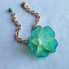 A big beautiful aqua flower (made from vintage lucite components) presents a corsage-like bracelet. Hanging from a matte electroplated gold rope. Aqua, Gold Rope Chains, Matte Gold, Flower Making, Big And Beautiful, Corsage, Craft Supplies, Fresh, Bracelets