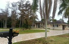 For sale, beautiful 1 acre estate home in Parkland, FL. Florida, Renta, Estate Homes, Acre, Sidewalk, New Homes, Beautiful, Shopping, Family Activities