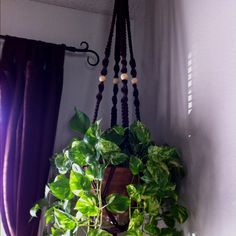 Plant hanger I made using the pattern from http://thisyearsdozen.wordpress.com/2009/05/27/how-to-macrame-a-plant-hanger/. Love it!!