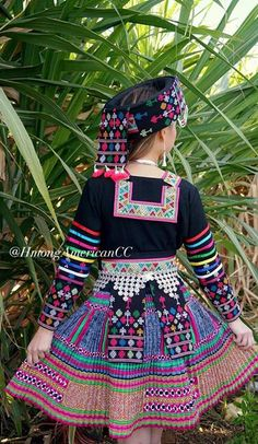 Mienh embroidery (paj co) on Hmong clothing (paj co designs on the hat, sash and lower sleeves)