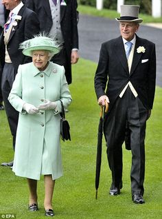The Queen and Prince Philip, in fine form following his admission to hospital just two weeks ago, walk towards the royal balcony ahead of the Ribblesdale Stakes today
