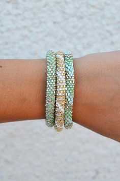 """Straight from a village in Nepal, these mint colored bracelets are the perfect symbol of free spirited style and living, complete with the collection's theme of """"Namaste"""". PLEASE NOTE: Every Lily & La"""