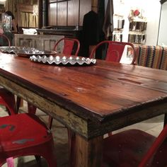 Upcycled dining room tables at 24e - wood is salvaged from historic Savannah homes. These are one-of-a-kind!