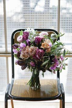 Blush and plum-toned bouquet by Pomp & Splendour | Emma and Steve's Newport Substation Wedding