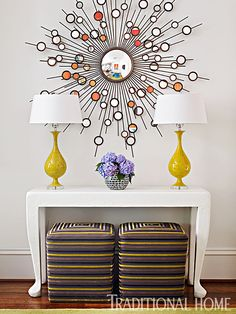 A starburst mirror reflects colors from artwork in the keeping room. - Photo: Emily Jenkins Followill / Design: Tish Mills