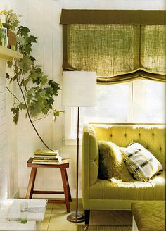 Love the green and white color palette, esp. that branch & roman shades.