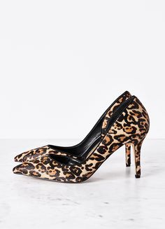 Our Ella pumps are slightly shorter then their big sister—our customer-favorite Olivia Pumps. Reach for this leopard-print haircalf pair to add cool-girl chic to distressed jeans and a duster. | White House Black Market
