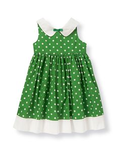 Chic polka dots embellish our collared dress for classic style. Crafted in crisp cotton poplin and fully lined in soft cotton batiste for exceptional comfort. Coordinating bloomer completes the ensemble (sizes up to 18-24 months only). Buttons in back assist with dressing.